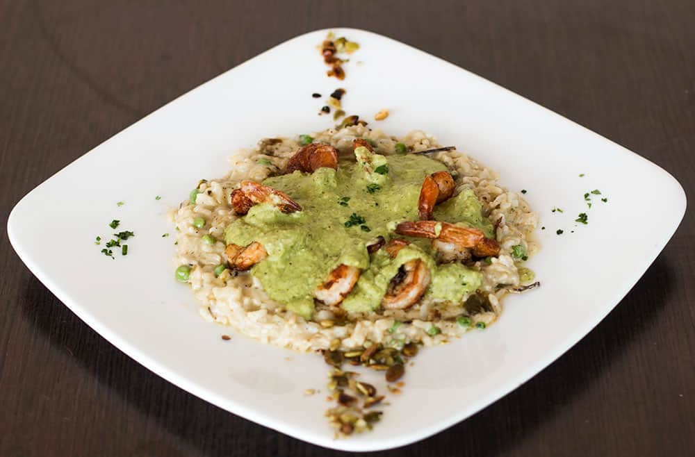 Shrimp Pipian Shrimp smothered in a variation of molé, made with raw pepitas, peanuts, sesame seeds, green tomatillos, serrano peppers and parsley. Served with a white rice and poblano pepper mix.