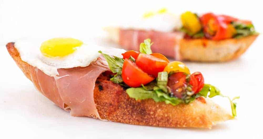 Bruschetta with Prosciutto, Tomato Basil and Quail Egg