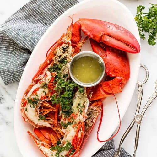 Easy boiled Lobster with homemade Lemon Butter Dip Sauce recipe. boiled lobster with garlic lemon butter dip sauce. Learn how to boil lobster in salted water and a trick on how to cook live lobster humanely.