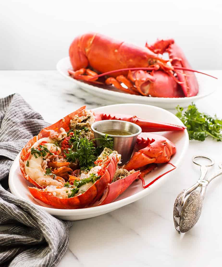 boiled lobster with garlic lemon butter dip sauce. Learn how to boil lobster in salted water and a trick on how to cook live lobster humanely.