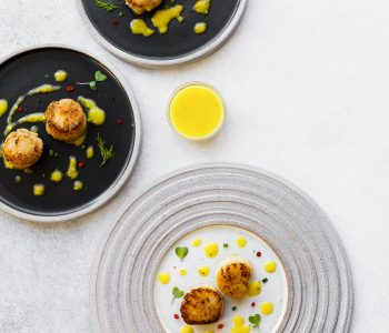 Looking for seafood appetizer recipes? Try these pan seared scallops, served with a tangy mango vinaigrette recipe. It's a great food and wine pairing recipe for your next party or special night.