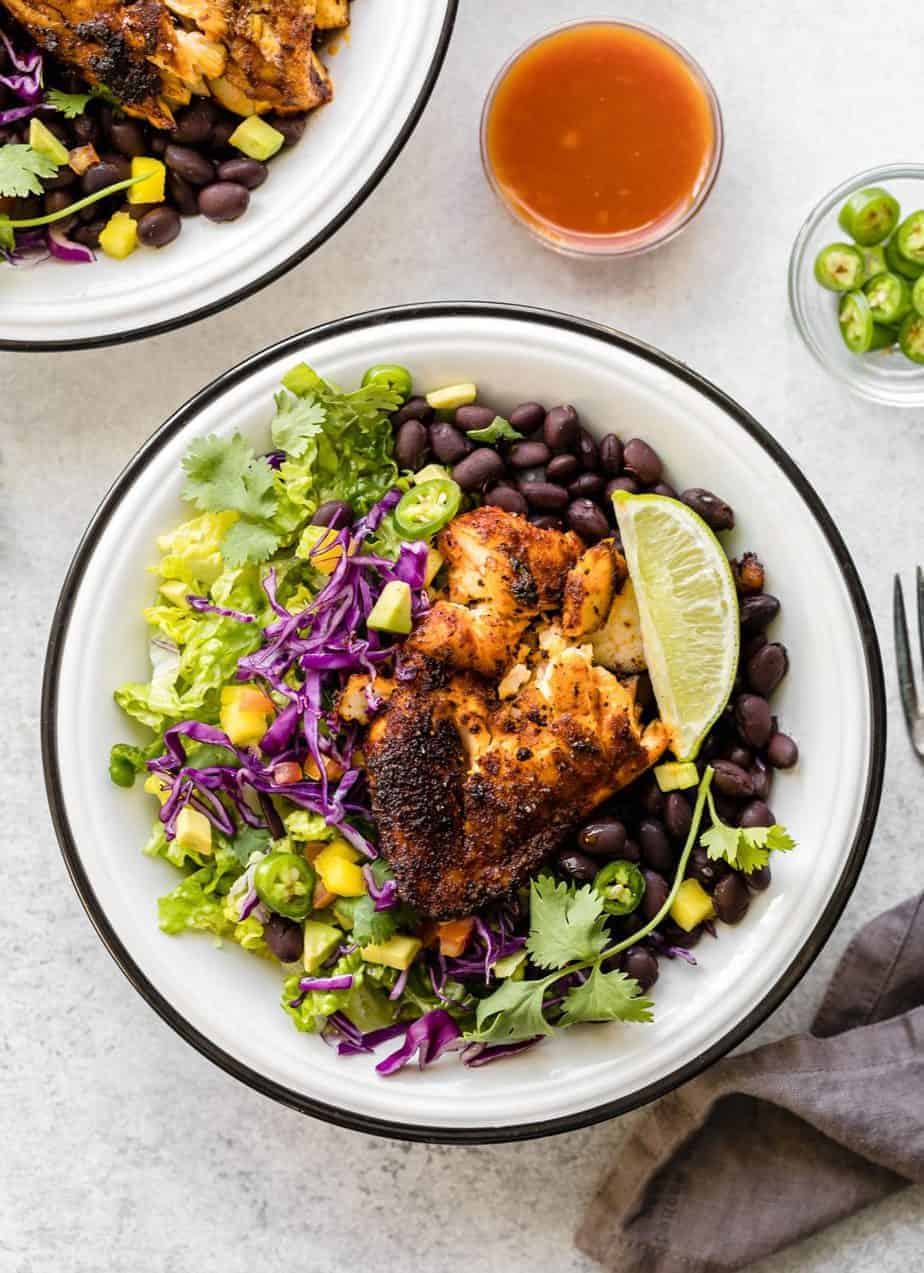 Stove Top Blackened Tilapia recipe, Cajun style, perfect for fish tacos or burrito bowl. Tilapia fillets, marinated in homemade blackened fish seasoning, then cooked in a heavy cast-iron pan.