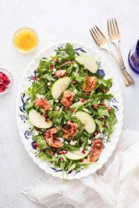 arugula salad with gorgonzola chees, prosciutto and white wine vinaigrette
