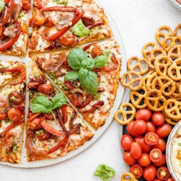 gluten free pizza with prosciutto and pesto