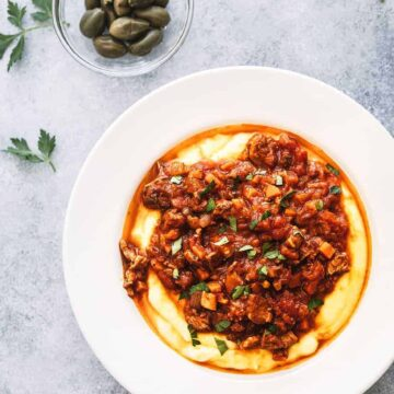 Slow Cooked Lamb Ragu served with creamy polenta