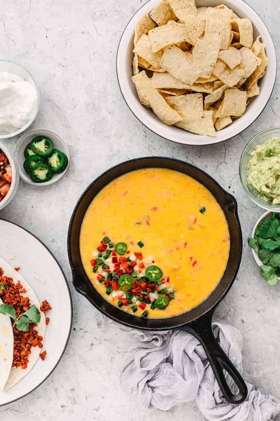 Instant Pot Queso Dip Recipe with Ground Beef, served with Mission Tortilla Strips