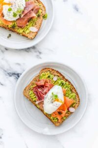 Smashed Avocado on Toast with Egg, Smoked Salmon, and Prosciutto