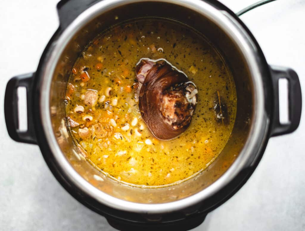 instant pot black-eyed pea soup with ham hock and bacon