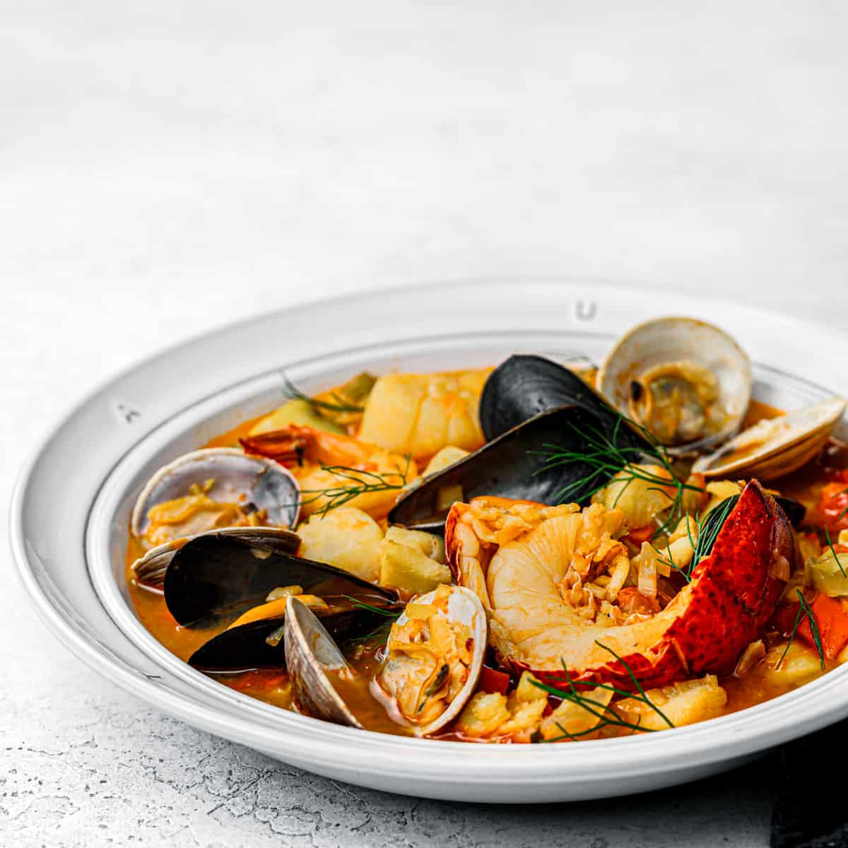 Fish stew with mussel, lobster, and shrimp.