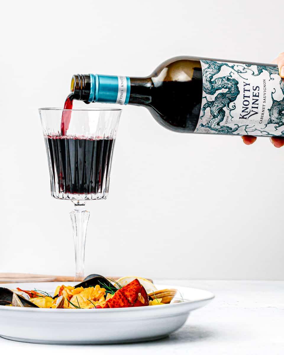 Knotty Vines Cabernet Sauvignon on a glass.