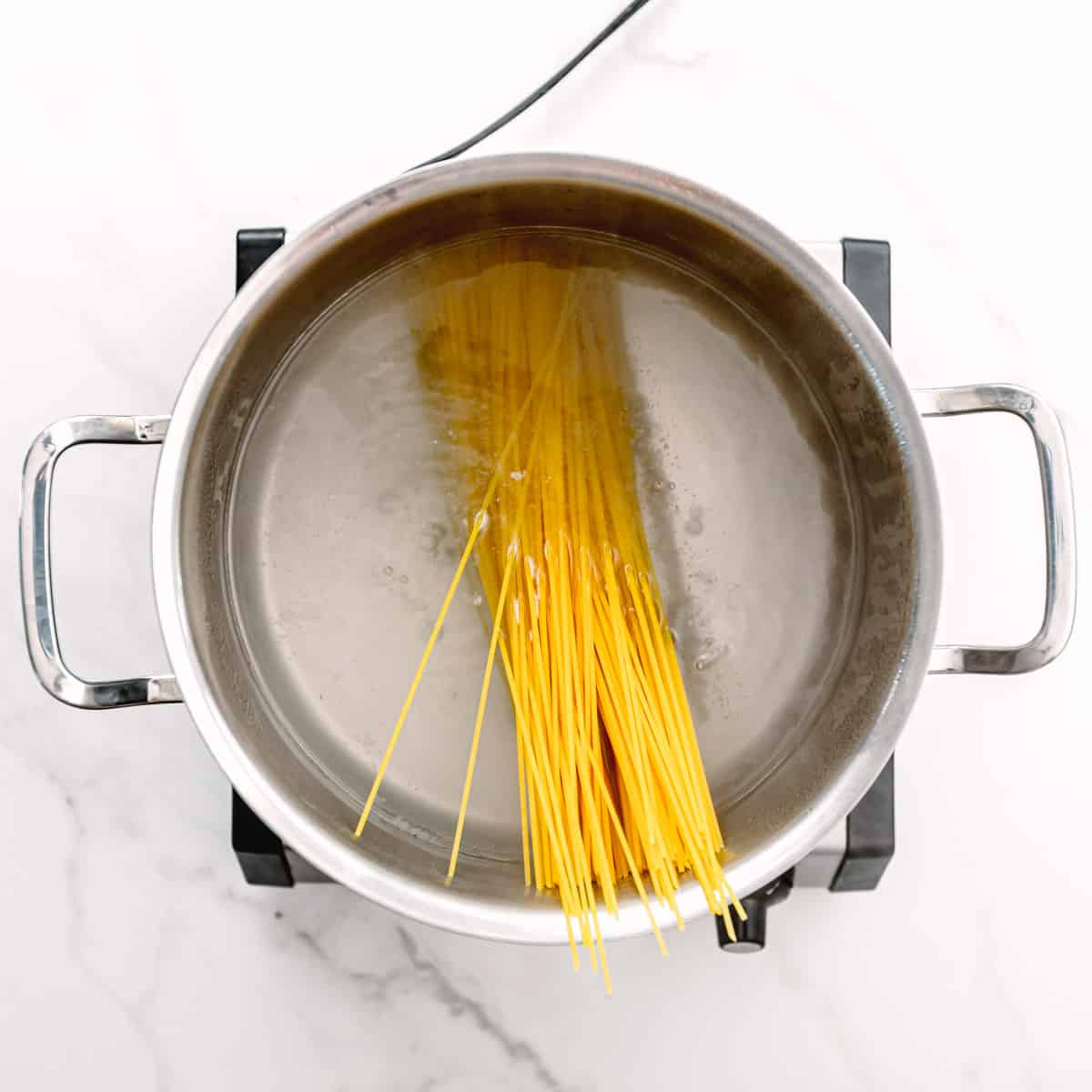 cooking spaghetti in salted water.