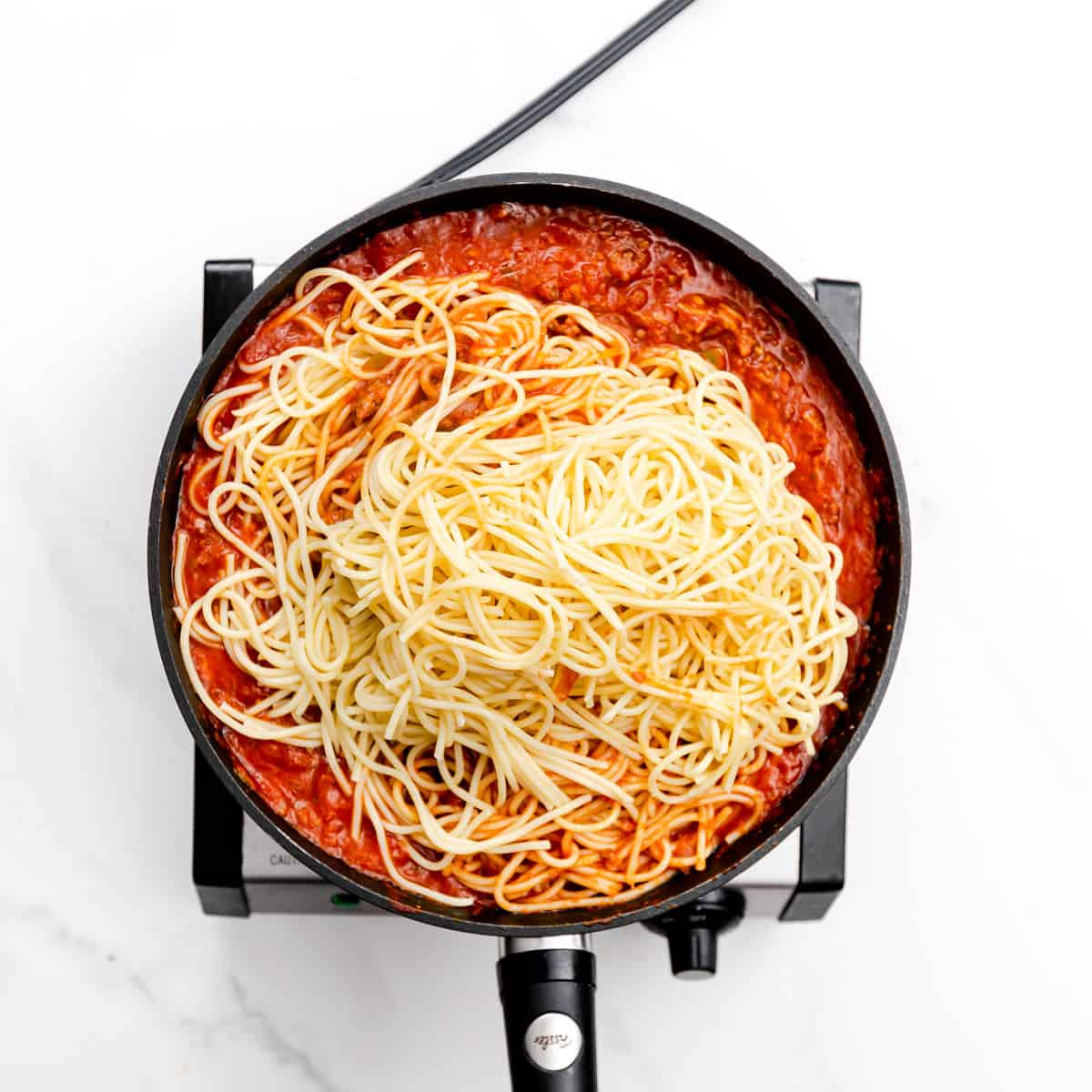 Add the cooked and drained spaghetti into the sauce. Stir for about 1-2 minutes.