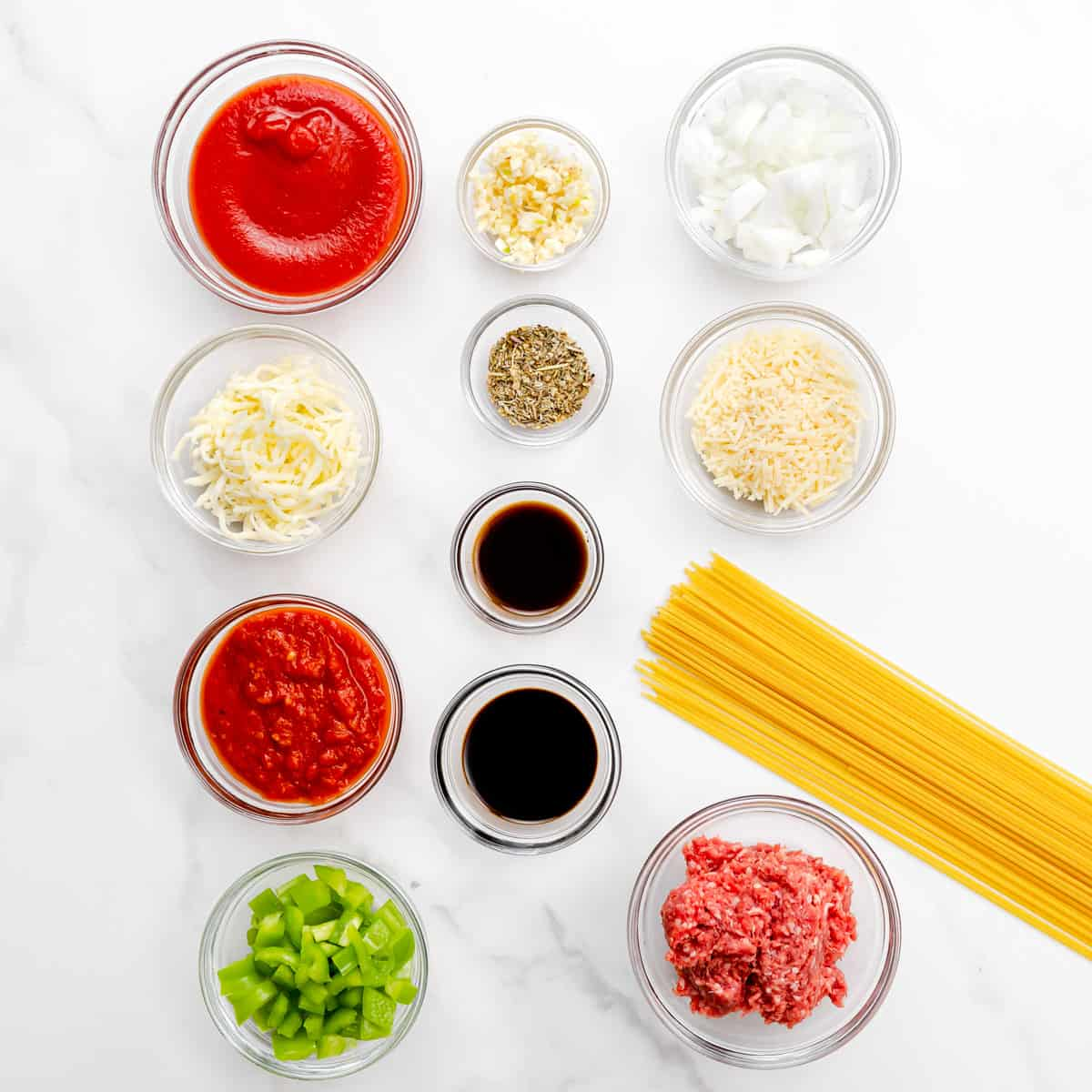 ingredients to make meat sauce for spaghetti.