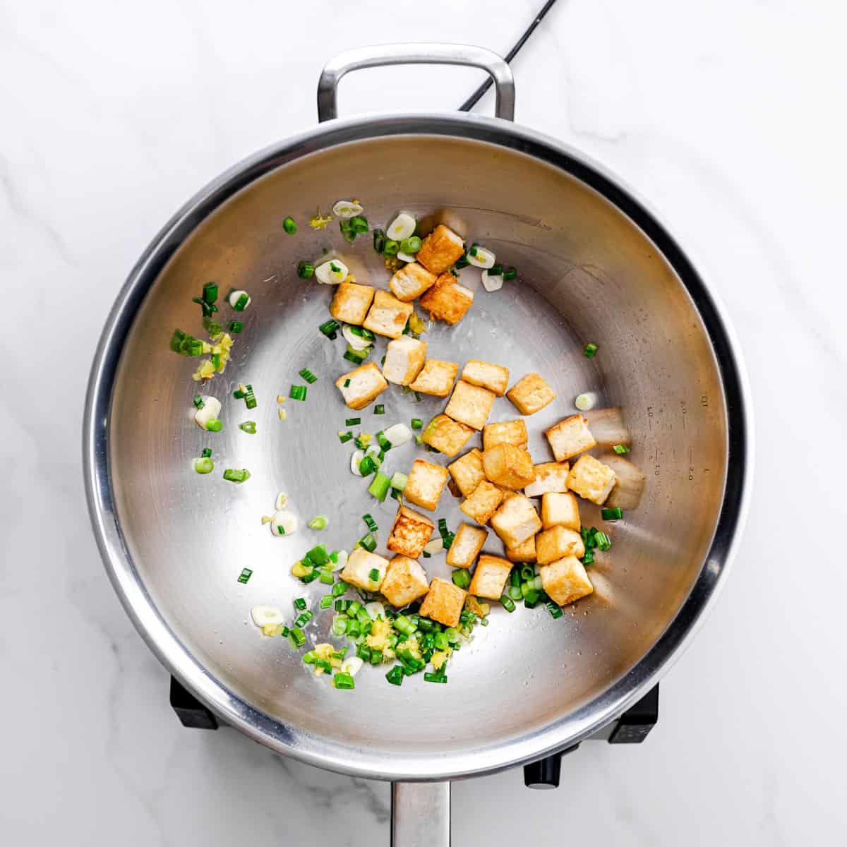 scallions, tofu, garlic, and ginger.
