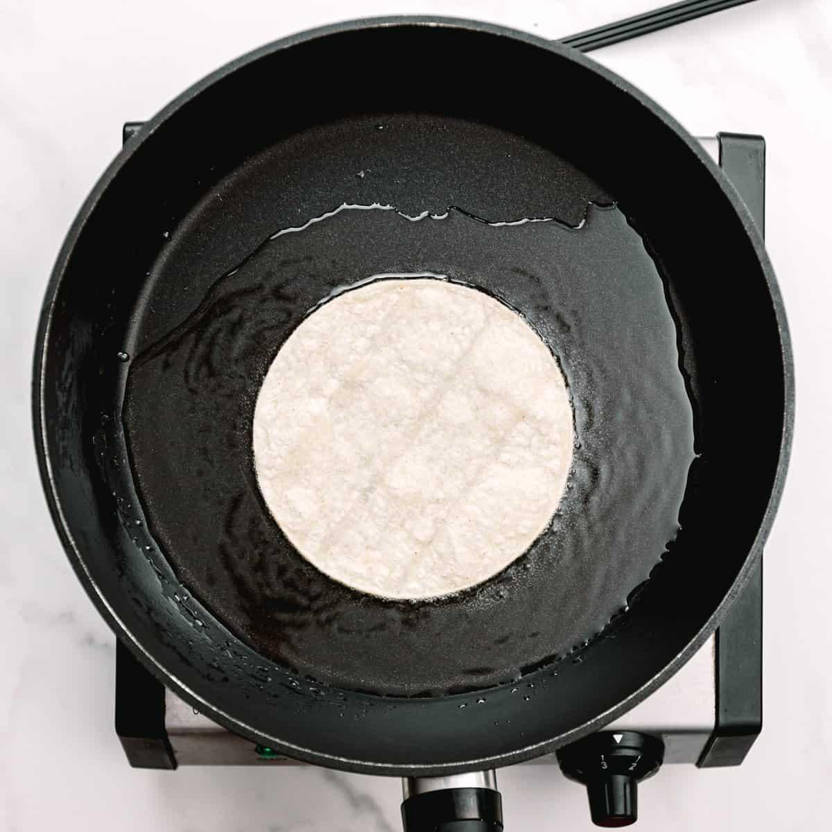 frying corn tortillas.