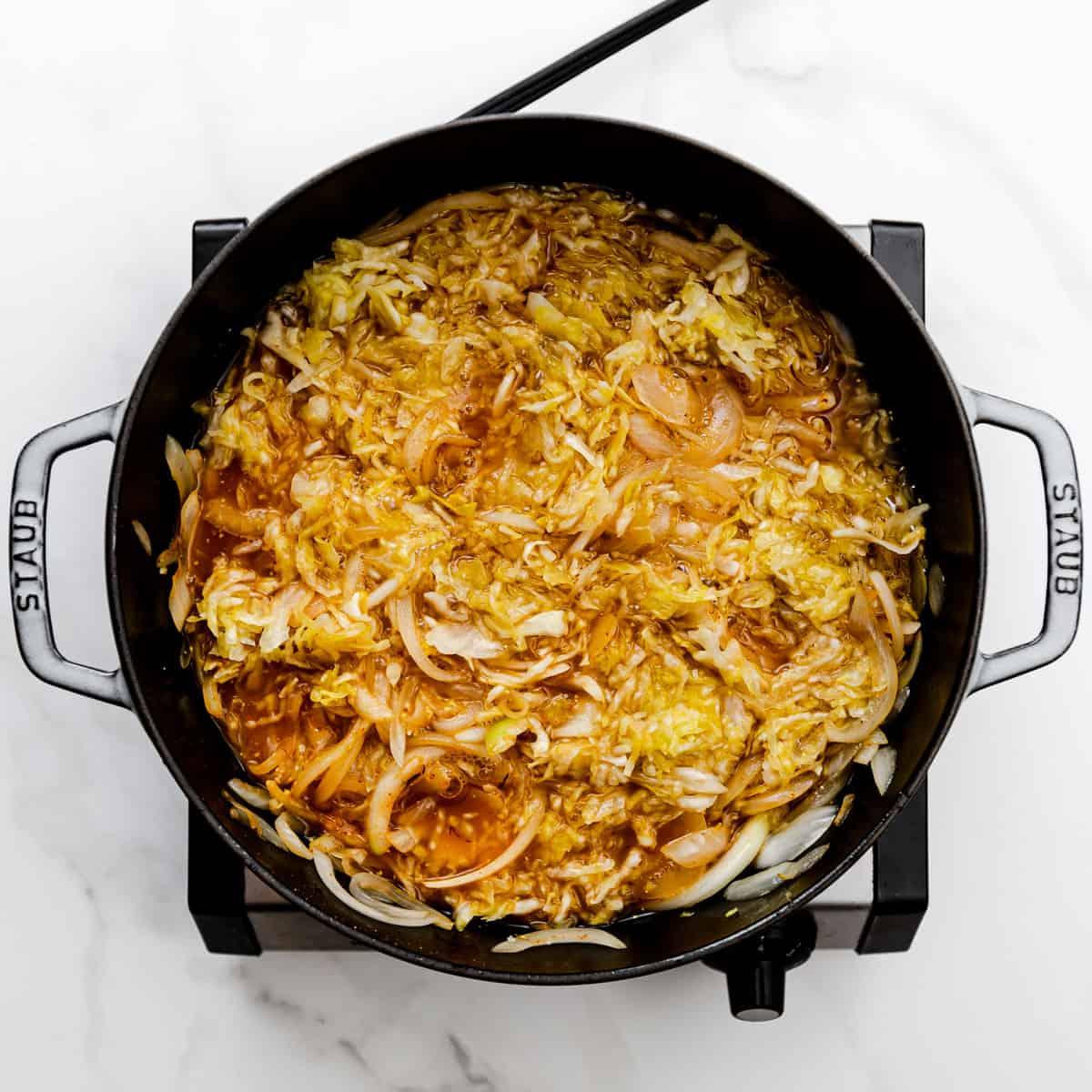 braising sausages with onion and sauerkraut.