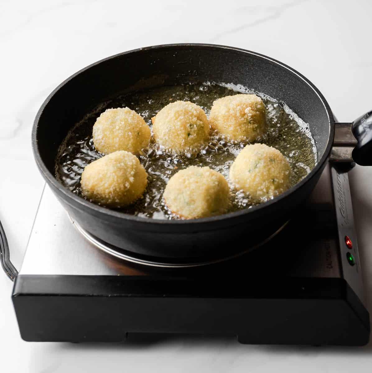 frying mashed potato balls.