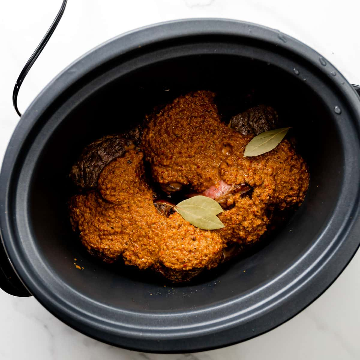 meat and seasoning in a slow cooker.